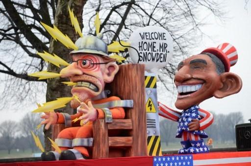 """奥巴马""""欢迎""""斯诺登回国。(PATRIK STOLLARZ / AFP)"""