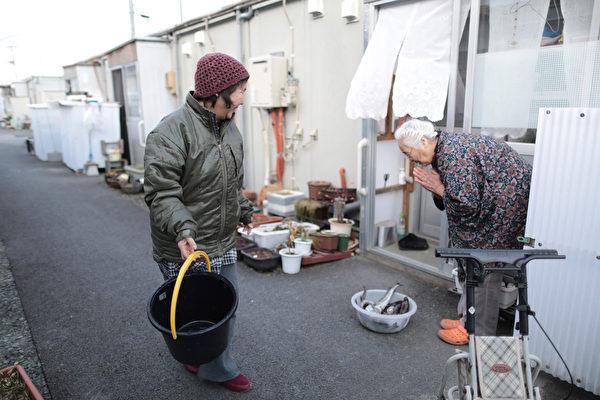 311东日本大地震發生3年後,仍有大量災民生活在臨時住所。(Yuriko Nakao/Getty Images)