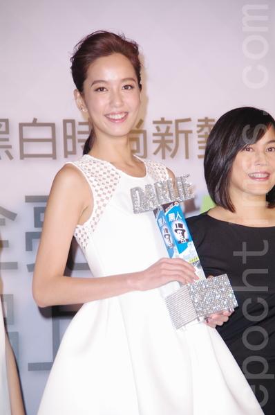陳庭妮於2014年3月15日在台北代言黑人牙膏新品活動,認為細緻的妝容加上白皙的牙齒,將為自己的美麗加分再晉級。(黃宗茂/大紀元)