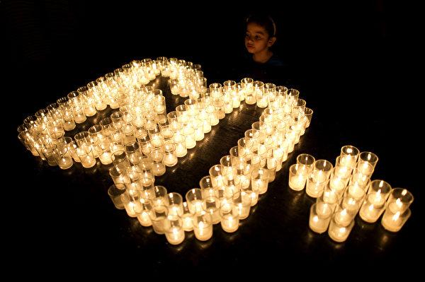 全球150個國家約7,000座城市,29日響應「地球一小時」(Earth Hour)熄燈活動。圖為菲律賓馬尼拉。(NOEL CELIS/AFP)