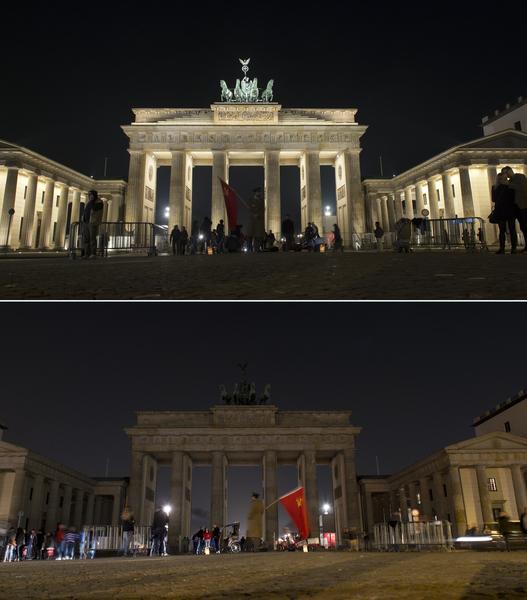 全球150個國家約7,000座城市,29日響應「地球一小時」(Earth Hour)熄燈活動。圖為德國柏林勃蘭登堡門。(JOHANNES EISELE/AFP)