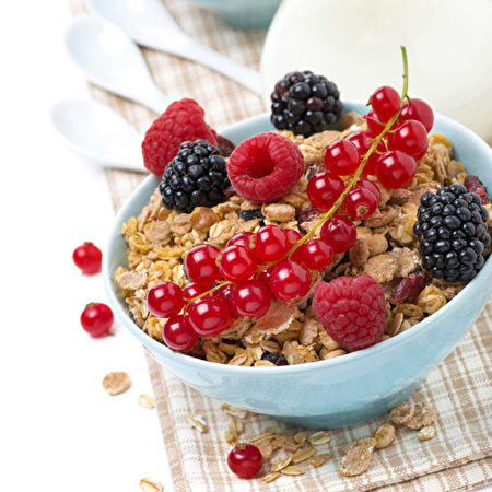 muesli with fresh berries and milk, close-up