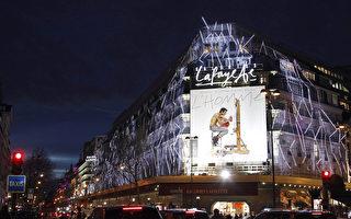 巴黎的7大旅遊中心等商店正在積極地爭取週日可以營業。圖為巴黎拉法耶百貨繁華的夜景。   (LUDOVIC MARIN/AFP/Getty Images)