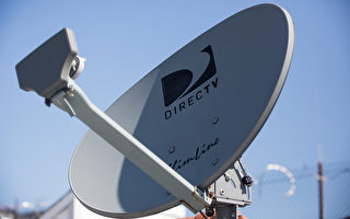 AT&T 18日宣佈出資490億收購DirecTV。(Andrew Burton/Getty Images)