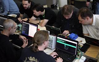 面對日益增長的網絡威脅,美國網絡司令部計劃在2015年招收4000人。同時在全球各地商業企業也都在競相僱傭網絡人才。( Adam Berry/Getty Images)