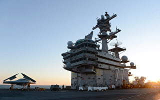 伊斯蘭武裝分子在伊拉克制造的暴亂與屠殺事件繼續升級。截止6月17日,美國國防部已經向波斯灣地區派駐更多兵力,包括一艘「喬治H.W.布什」航空母艦(圖)、5艘軍艦、十多架直升機和500多名海軍陸戰隊成員。這些裝備和人員隨時等待美國總統奧巴馬的命令。(U.S. Navy via Getty Images)