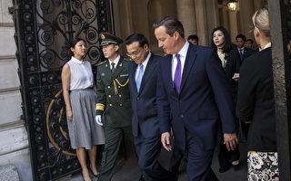 """6月17日,中共国务院总理李克强访问英国的第二天,中英发表联合声明,提及""""一国两制""""和基本法,但没有提中共""""国新办""""10日抛出的香港白皮书,英国也没主动谴责白皮书。(Rob Stothard/Getty Images)"""