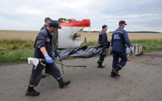 7月21日,马航MH17坠毁时遇难的298名人员的遗体,现已经寻获逾270具,但目前遗体仍将会留在顿涅茨克由叛军控制的火车上。(DOMINIQUE FAGET/AFP PHOTO)