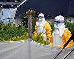 醫生無疆界組織的工作人員在非常進行防疫工作。(AFP PHOTO / CELLOU BINANI)