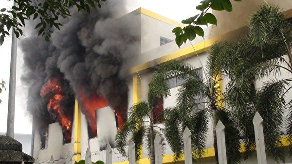 2014年5月14日,抗议中共在南海西沙群岛海域开采石油,越南南部共有15间外资工厂遭到纵火。图为平阳一家工厂遭纵火。(VNExpress/AFP)