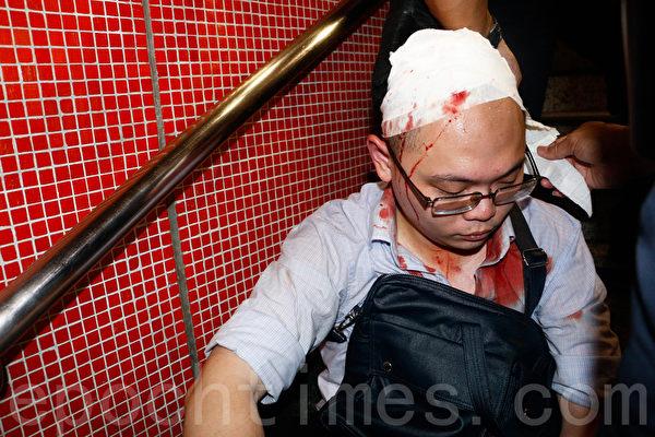市民熊先生被反占中人士用硬物殴打致头破血流。(蔡雯文/大纪元)