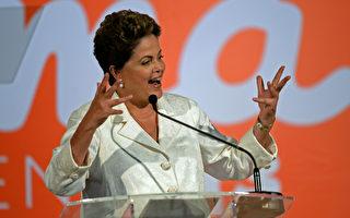 10月29日(周三)巴西央行宣布将基准利率上调25个基点至11.25%,达到3年来最高水平。图为巴西女总统罗塞夫(Dilma Rousseff),她在10月26日获得连任。(EVARISTO SA/AFP)