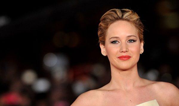珍妮佛‧劳伦斯是票房最高的动作电影女明星。(TIZIANA FABI / AFP)