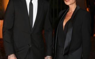 """据估计,克汉姆夫妇现在的财产达到2.1亿镑,其中1亿镑是贝嫂名下的。图为2013年9月16日,克汉姆夫妇出席了伦敦""""全球基金""""的庆典活动。(Chris Jackson/Getty Images)"""