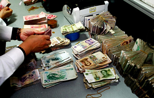 对于减息的另一个原因,廖仕明认为是因为大陆银行闹钱荒。(AFP)