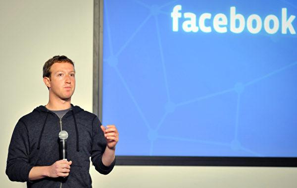 脸书(Facebook)创始人暨首席执行长扎克伯格(Mark Zuckerberg,又译:祖克伯)是史上最年轻的自行创业亿万富豪 。(Josh Edelson/AFP/Getty Images)
