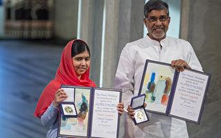 巴基斯坦教育维权人士马拉拉(左)和印度儿童权利活动人士萨蒂亚尔(右)12月10日在挪威奥斯陆领取了诺贝尔和平奖。(Nigel Waldron/Getty Images)