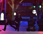 12月15日晚,澳大利亚悉尼市中心一家咖啡馆人质劫持现场枪声大作。劫持者和悉尼警方交火,已知3人死亡、5人受伤。(AFP PHOTO/Peter PARKS)