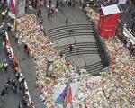 悉尼马丁广场上堆满了大片的鲜花。(Cole Bennetts/Getty Images)