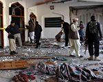 巴基斯坦1间什叶派清真寺13日遭到塔利班好战分子自杀攻击,造成至少20人丧生。(A Majeed/AFP/Getty Images)