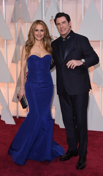 約翰‧特拉華塔與妻子。(MARK RALSTON/AFP/Getty Images)