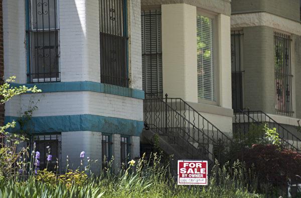 建议购房者选择适合自己的按揭方案。(JIM  WATSON/AFP)