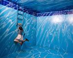 泰国清迈的幻觉艺术博物馆中,各种逼真的壁画让人信以为真。(Taylor Weidman/Getty Images)