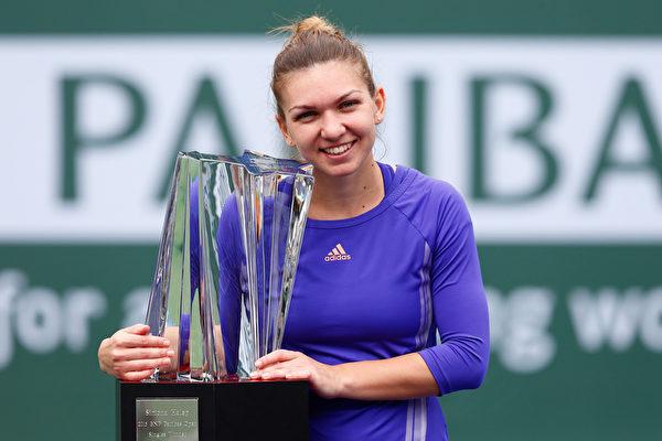 罗马尼亚新星哈勒普夺个人迄今为止最重要的冠军。(Julian Finney/Getty Images)