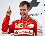 维特尔夺得自己加盟法拉利车队后的首个冠军。(Lars Baron/Getty Images)