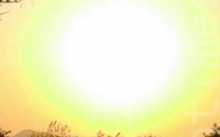 同一地连拍奇景 红光晕球环绕太阳