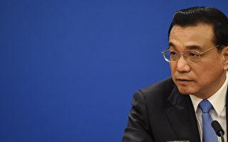 """港媒披露,中共国务院考核地方省部级高官的结果是""""六问六不知"""",这气坏了总理李克强。(DUFOUR/AFP/Getty Images)"""