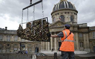 """穿着黄色背心的工作人员6月1日来到巴黎艺术桥(Pont des Arts),出动切割装备来移除""""爱情锁""""。 (AFP)"""