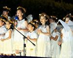 台灣法輪功學員18日在台北凱道舉行燭光悼念會,許多小弟子上台呼籲救援在大陸因父母修煉法輪功而受迫害的孤兒。(白川/大紀元)