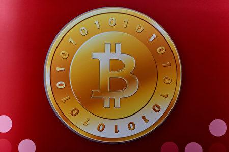 全球最大虛擬貨幣「比特幣」因中國投機客炒作而飆破700美元兩年最高價。(Philippe Lopez/AFP)