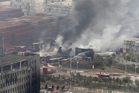 據報導,天津週三晚上大規模的爆炸發生在倉庫報告起火40分鐘之後,以及在第一輪消防員抵達之後。(AFP PHOTO)