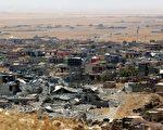 本图为饱受战火摧残的伊拉克摩苏尔市。(SAFIN HAMED/AFP/Getty Images)
