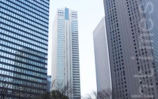 近年,来自欧美、中国的热钱涌入日本房地产,大量购买日本大都市的商业设施的大楼,使房地产市场出现过热现象。图为日本商业黄金地段新宿办公楼群。(卢勇/大纪元)
