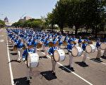 纽约天国乐团十年辉煌历程。纽约天国乐团2015年7月20日,参加美国首都华盛顿DC法轮功纪念7.20解体中共结束迫害大游行。(戴兵/大纪元)