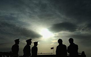 习近平于上周的阅兵式上宣布裁军30万后,外界不少评论对此进行分析。 (Feng Li/Getty Images)