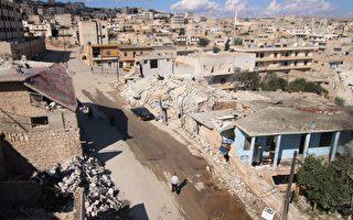圖為10月7日,阿薩德政府軍在俄羅斯空襲支援下,地面部隊攻擊反抗軍位於東阿勒頗省(Aleppo)的Darat Azzah鎮,圖為該鎮被襲後損壞的大樓建築。(Fadi al-Halabi/AFP/Getty Images)