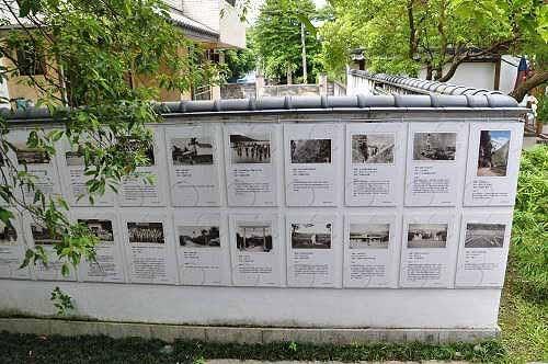 庆修院寺墙贴著吉野移民村时代的花莲老照片。  (图片提供:tony)