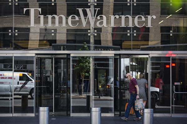 """查特收购时代华纳后,时代华纳数千名为使用高速互联网服务而自行购买调制解调器(Modem,或称""""数据盒"""")的用户,可能需要租用查特的调制解调器。(Andrew Burton/Getty Images)"""