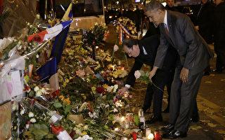 美国总统奥巴马准备出席11月30日联合国在巴黎举行的气候峰会。奥巴马在29日晚抵达巴黎,旋即到巴塔克兰音乐厅献花,向巴黎恐袭遇难者致意。(AFP/POOL/PHILIPPE WOJAZER)