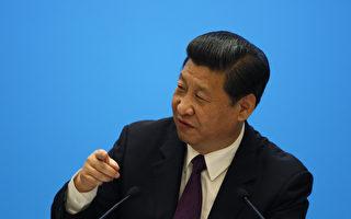 """日前,习近平在中纪委全会上发言称""""反腐败斗争压倒性态势正在形成"""",与去年反腐""""还没有取得压倒性的胜利""""的说法相比,有明显突破。(Tyrone Siu/POOL/AFP)"""
