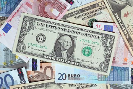 世界多家机构预计,2016年全球经济会有所好转,发达国家增长稳定,但是新兴市场面临危机。(Dan Kitwood/Getty Images)