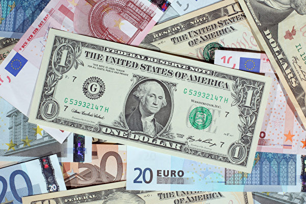 世界多家機構預計,2016年全球經濟會有所好轉,發達國家增長穩定,但是新興市場面臨危機。(Dan Kitwood/Getty Images)