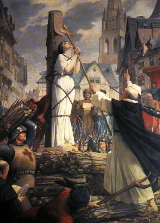 貞德被綁在火刑柱上,手握著十字架祈禱,為法國新古典主義畫家Jules-Eugène Lenepveu的作品。(維基百科公共領域)
