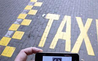 優步(Uber)私家車出租服務公司與魁省政府簽署了為期1年的試點項目協議(NICOLAS MAETERLINCK/AFP/Getty Images)