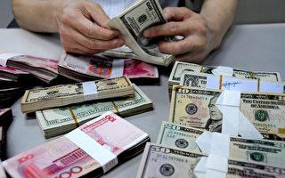 民币兑美元中间价连续三天调降。5月6日调降74点,报6.5202,为今年3月28日以来最低。(ChinaFotoPress/Getty Images)