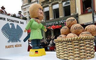 德国狂欢节花车亮点:难民潮卷走默克尔
